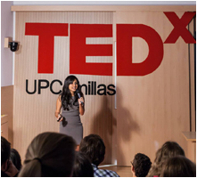 Sanjna speaking at a TEDx event in Madrid.